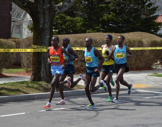 Male front runners, including winner Lelisa Desisa, Boston Marathon, 2013. Photo by Rick Chalmers